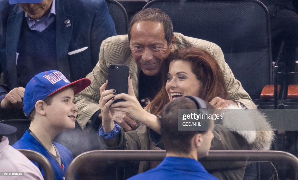 Debra Messing and son, Roman Zelman take a selfie with Paul Anka during the Ottawa Senators Vs. New York Rangers 2017 Playoff Game on May 9, 2017 at Madison Square Garden in New York City.