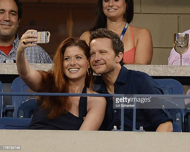 Debra Messing and Will Chase attend the 2013 US Open at USTA Billie Jean King National Tennis Center on August 30 2013 in New York City