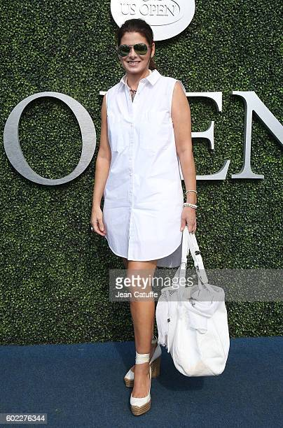 Debra Messing arrives for the women's final at Arthur Ashe Stadium on day 13 of the 2016 US Open at USTA Billie Jean King National Tennis Center on...