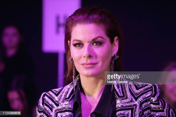 Debra Messing attends the Naeem Khan runway show in Gallery I of Spring Studios during New York Fashion Week The Shows at Spring Studios on February...