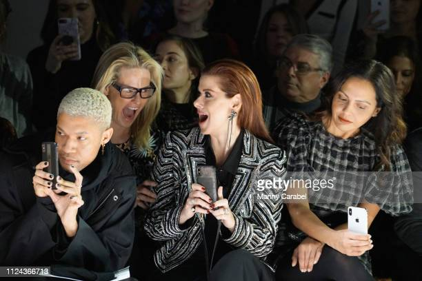 Debra Messing sits front row during the Naeem Khan runway show in Gallery I of Spring Studios during New York Fashion Week The Shows at Spring...