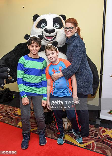 Debra Messing with her son Roman Walker Zelman and guest attend the 'Kung Fu Panda 3' New York screening at AMC Loews Kips Bay 15 theater on January...