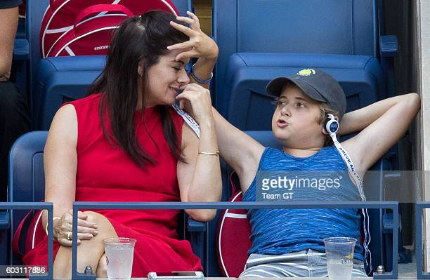 Debra Messing with son Roman seen at USTA Billie Jean King National Tennis Center on September 11 2016 in the Queens borough of New York City