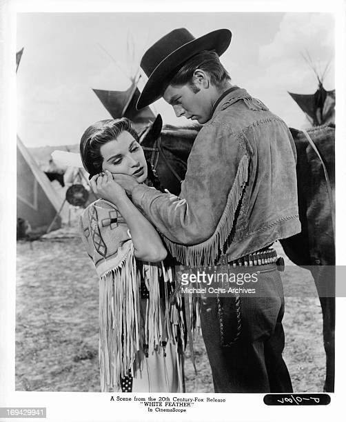 Debra Paget finds comfort in the hand of Robert Wagner in a scene from the film 'White Feather' 1955