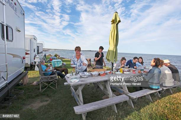 Debra Roy of Ayerscliff Quebec Canada serves a bbq dinner for visiting NH family on the last night of her twoweek vacation at Libbys Oceanside Camp...