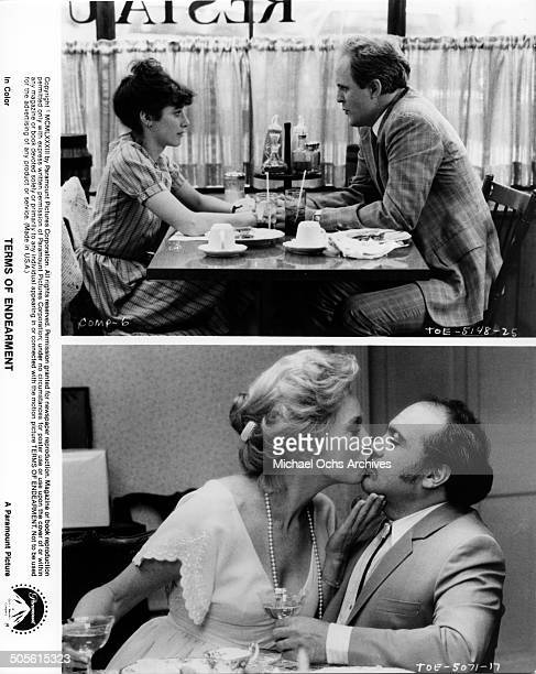 Debra Winger meets with John Lithgow in a diner Shirley MacLaine kisses Danny DeVito in a scene from the Paramount Pictures movie Terms of Endearment...