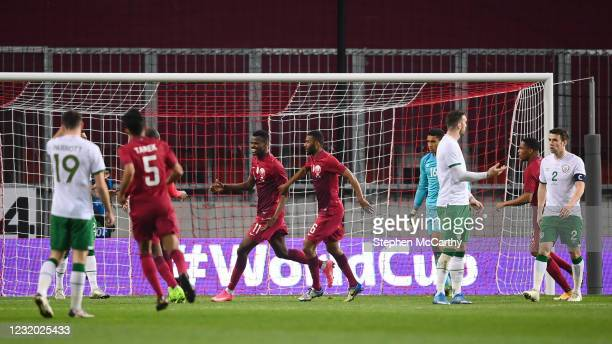 Debrecen , Hungary - 30 March 2021; Mohammed Muntari celebrates after scoring his side's first goal with his Qatar team-mate Abdelaziz Hatim during...