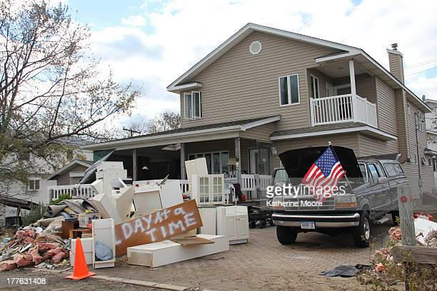 CONTENT] Debris a spraypainted message and an American flag surround a Queens home damaged during Superstorm Sandy