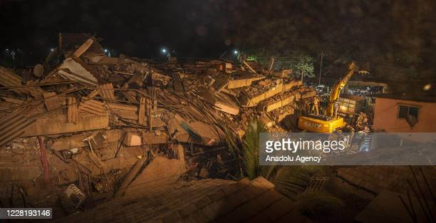 Debris after a five-story building is seen after it collapsed as rescue workers search for survivors continue in Mahad of Raigad district in the...