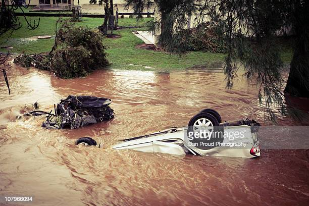 Debris and an overturned car are seen in central Toowoomba between 1500 and 1700 hours AEST following a flash flood which ripped through the town...