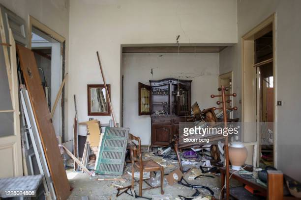 Debris and broken furniture fills the living room area inside a badly damaged residential building near the Port of Beirut in Beirut, Lebanon, on...