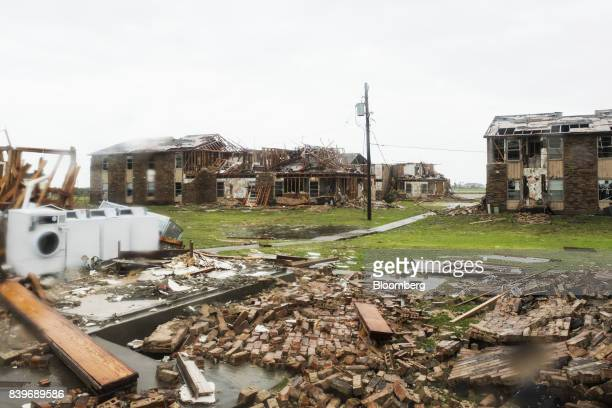Debris and damaged hosing complex are seen after Hurricane Harvey hit Rockport Texas US on Saturday Aug 26 2017 As Harvey's winds die down trouble...