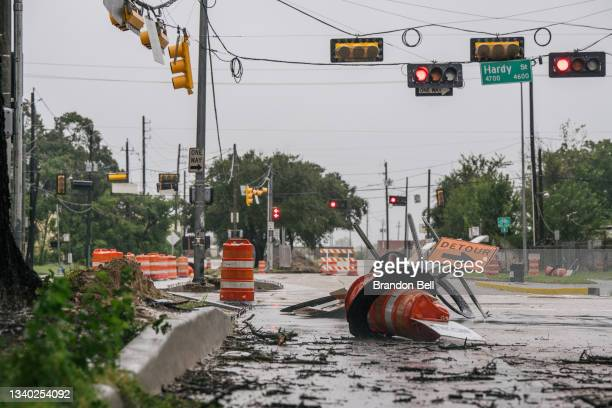 Debris and damaged road construction are left after Tropical Storm Nicholas moved through the area on September 14, 2021 in Houston, Texas. Tropical...