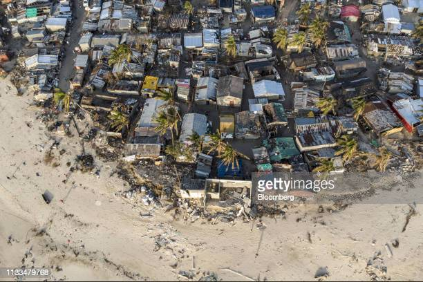 Debris and destroyed buildings from the cyclone stand in this aerial photograph over over the Praia Nova neighborhood in Beira Mozambique on...