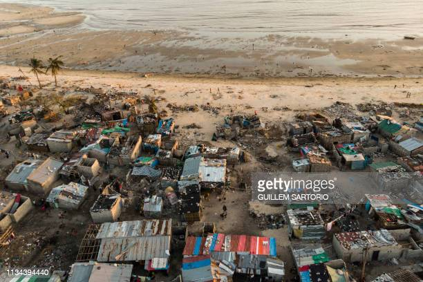 TOPSHOT Debris and destroyed buildings which stood in the path of Cyclone Idai can be seen in this aerial photograph over the Praia Nova...