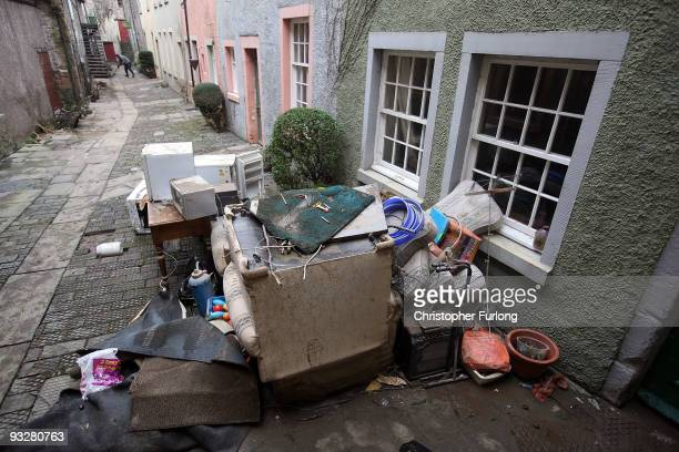 Debris and household goods are piled up as flood water recedes and the big clean up of debris and damage begins on November 21, 2009 in Cockermouth,...