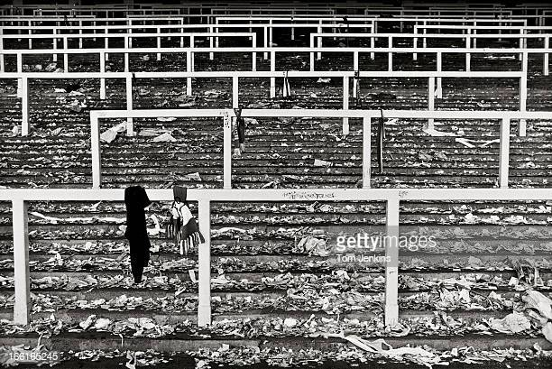 Debris and mementos left by Liverpool fans on the Kop standing area after the final game before it was demolished and replaced with seats following...