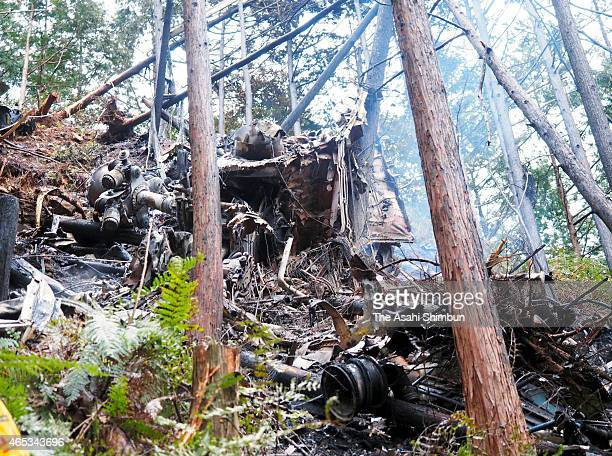Debris and parts are scattered after a helicopter crash on March 6 2015 in Kihoku Mie Japan The helicopter owned by a company 'Shin Nihon Helicopter'...