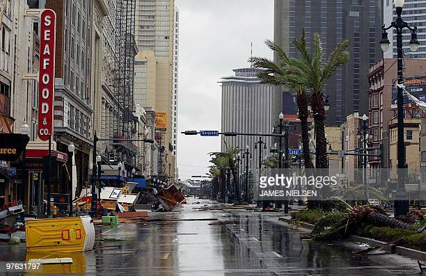 Debris are scattered across Canal street in the French quarter of New Orleans 29 August 2005 as Hurricane Katrina makes landfall Hurricane Katrina...