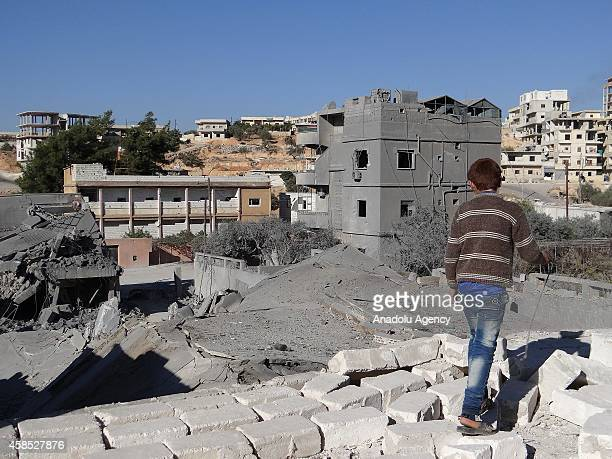 Debris are seen following a USled coalition airstrike hits Headquarters of al Nusra Front in Aleppo Syria on November 06 2014
