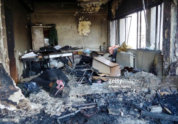 Debris are seen inside a building after a twin suicide bombing attack following a carbomb explosion on a police station in alMidan Neighborhood of...