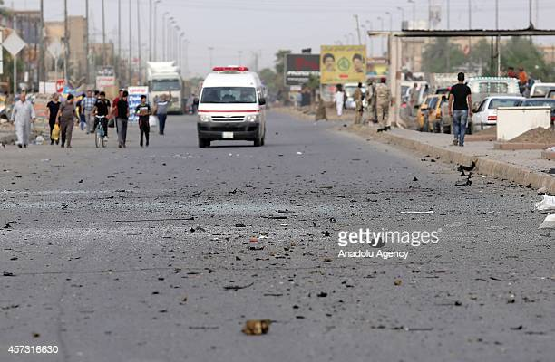 Debris are seen on the road after a car bombing attack 6 people dead also wounded at least 21 people in Talbiyah region of Baghdad Iraq on October 16