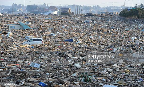 Debris cover a large area in Natori near Sendai in Miyagi prefecture on March 13 2011 after the March 11 earthquake and tsunami Japan battled a...