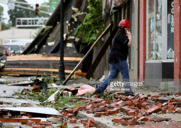 Debris cover Main Street outside buildings damaged by a tornado in Webster MA on Aug 4 2018 A tornado along with intense rain hit Central...