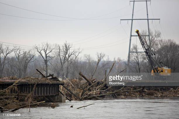 Debris covers a collapsed section of a Union Pacific Corp rail bridge over the Platte River in La Platte Nebraska US on Sunday March 24 2019 The...