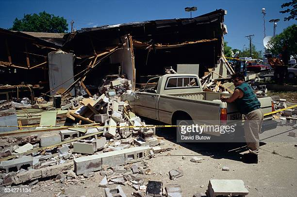 Debris covers a nearby sidewalk in the aftermath of the Oklahoma city bombing On April 19 Timothy McVeigh exploded a truck bomb outside of the Alfred...