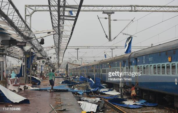 Debris covers the train tracks and platforms at the stormdamaged railway station on May 4 2019 in Puri India At least 12 people are reported to have...