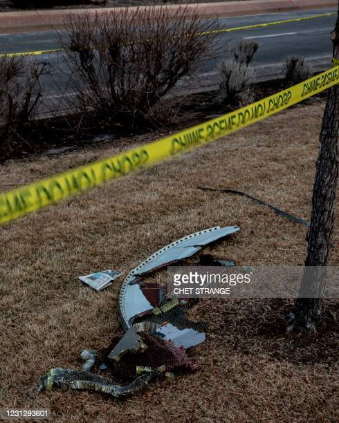Debris fallen from a United Airlines airplane's engine lay scattered through the neighborhood of Broomfield, outside Denver, Colorado, on February...
