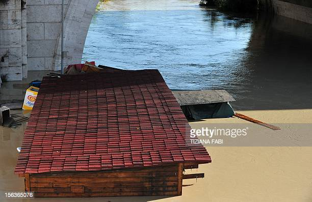 Debris float in the Tiber river as its level is rising on November 14 2012 in Rome Flooding struck the northern outskirts of Rome on Wednesday after...