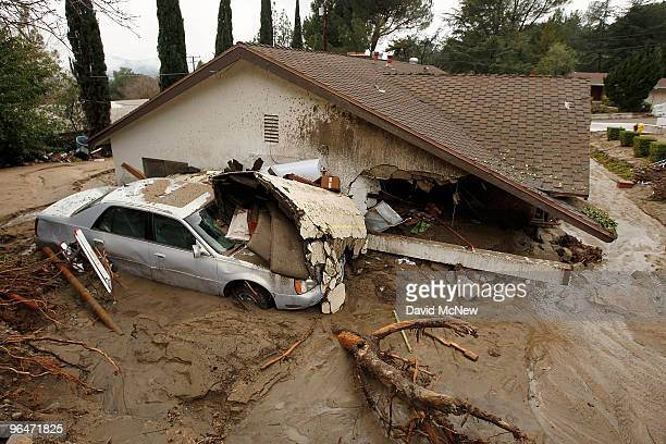 A debris flow damages a home after heavy rains caused mudslides February 6 2010 in La Canada Flintridge California Large wildfires in 2008 and 2009...