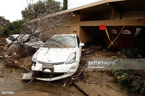 A debris flow damages a home and cars after heavy rains caused mudslides February 6 2010 in La Canada Flintridge California Large wildfires in 2008...
