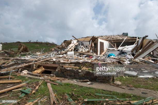 Debris from a destroyed building are strewn across the land in Oyster Pond on the French Caribbean island of Saint-Martin three weeks after the...