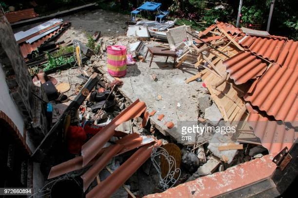 Debris from a house affected by an earthquake is seen on June 12 in Briceno Narino department Colombia A shallow earthquake measuring 43 degrees at...