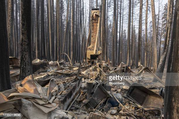 Debris from a house that burned down during the Caldor Fire in Twin Bridges, California, U.S., on on Thursday, Sept. 2, 2021. Firefighters managed to...