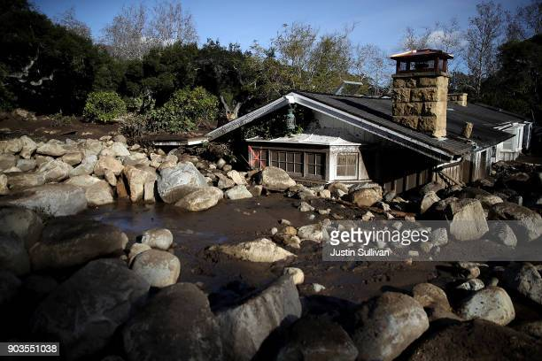 Debris from a mudslide covers a home on January 10 2018 in Montecito California 15 people have died and hundreds are still stranded after massive...