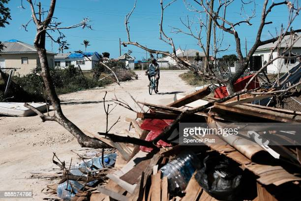 Debris from damaged homes lines a street on the nearly destroyed island of Barbuda on December 8 2017 in Cordington Barbuda Barbuda which covers only...