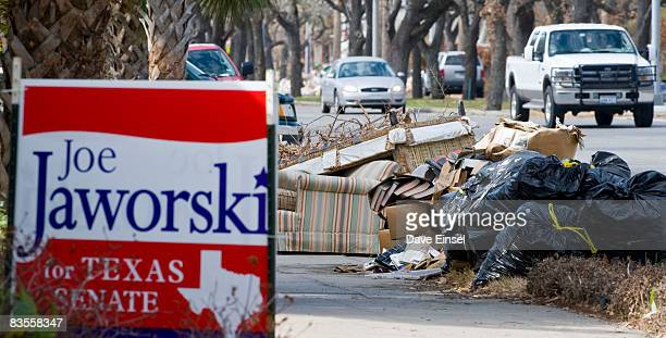 Debris from Hurricane Ike still lines Broadway Boulevard November 4 2008 in Galveston Texas Voter turnout has been light as residents are still in...
