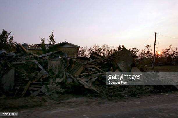 Debris from Hurricane Katrina lines the streets September 12 2005 in Waveland Mississippi Thousands of residents of the Gulf Coast are still without...