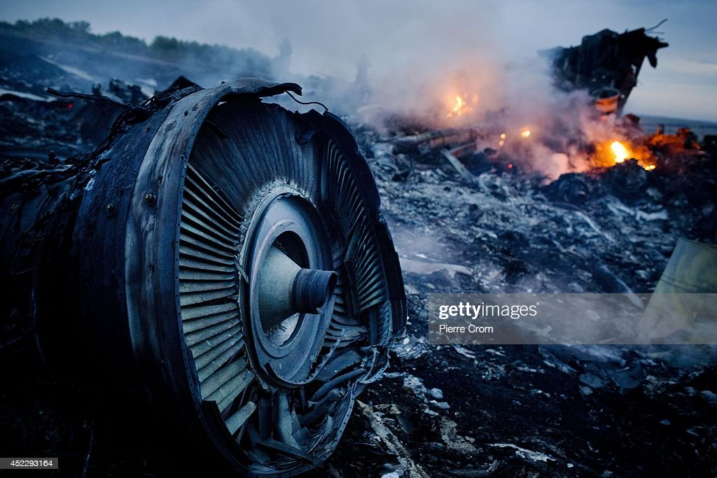 Debris from Malaysia Airlines Flight 17 is shown smouldering in a field July 17, 2014 in Grabovo, Ukraine near the Russian border. Flight 17, on its way from Amsterdam to Kuala Lumpur and carrying 295 passengers and crew, is believed to have been shot down by a surface-to-air missile, according to U.S. intelligence officials and Ukrainian authorities quoted in published reports. The area is under control of pro-Russian militias.