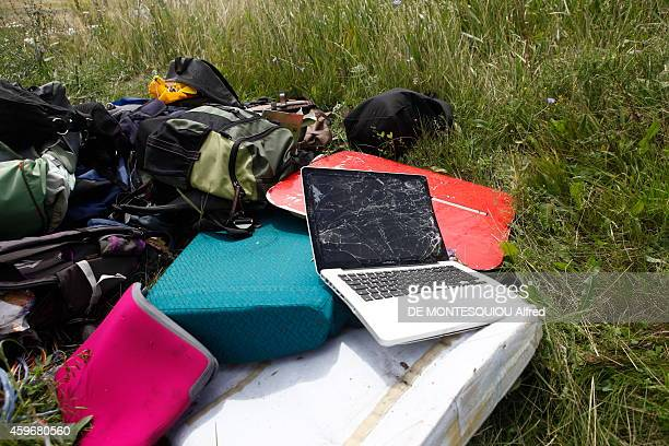 Debris from the Boeing 777 Malaysia Airlines MH17 AmsterdamKuala Lumpur with 295 people aboard including 15 crew members crashed in eastern Ukraine...