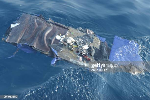 Debris from the illfated Lion Air flight JT 610 floats at sea in the waters north of Karawang West Java province on October 29 2018 All 189...
