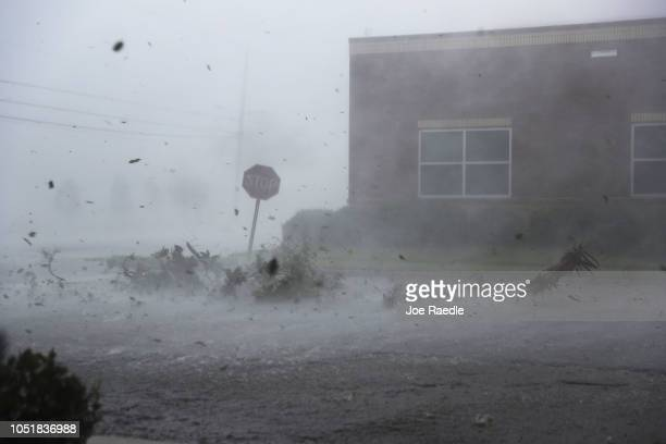 Debris is blown down a street by Hurricane Michael on October 10 2018 in Panama City Florida The hurricane made landfall on the Florida Panhandle as...