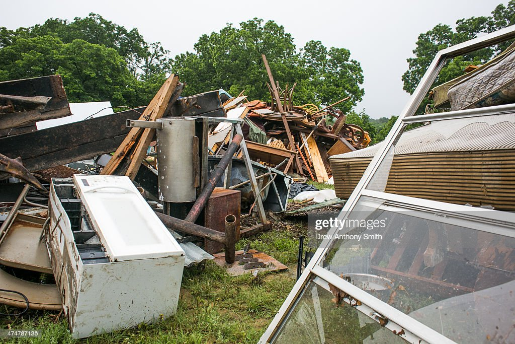 Debris is collected in front of Rio Bonito Resort May 26, 2015 in Wimberley, Texas. Central Texas has been hit with severe weather, including catastrophic flooding and tornadoes over the past several days.