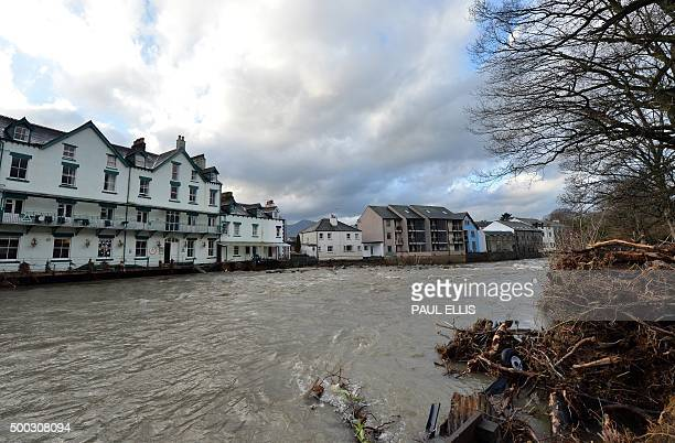 Debris is left on the river bank after the river Greta flooded in Keswick north west England on December 7 2015 Prime Minister David Cameron was to...