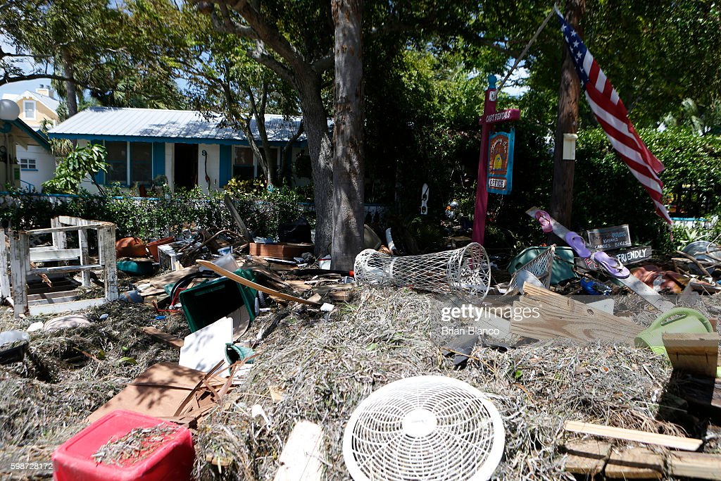 Debris is left outside of the Faraway Inn, left behind by the winds and storm surge associated with Hurricane Hermine which made landfall overnight in the area on September 2, 2016 in Cedar Key, Florida. Hermine made landfall as a Category 1 hurricane but has weakened back to a tropical storm.