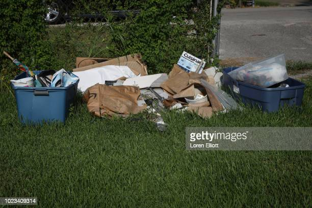 Debris is pictured in the yard of a home badly damaged by Hurricane Harvey in the Kashmere Gardens neighborhood on August 25 2018 in Houston Texas...